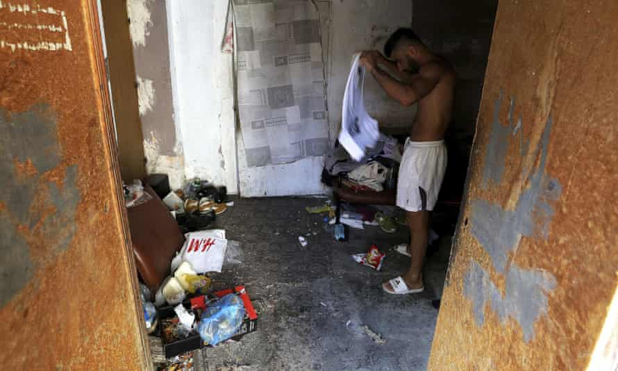 A migrant from Iraq in his makeshift accommodation in Nicosia
