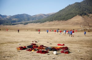 Buddhist monks swap their robes for Manchester United and Chelsea shirts to play football in the Phobjikha Valley.
