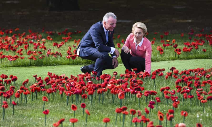The director of the Australian War Memorial Brendan Nelson and German Defence Minister Ursula von der Leyen take a look at a field of handmade poppies in the sculpture garden of the Australian War Memorial