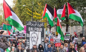 Protesters take part in a march in London organised by the Palestine Solidarity Campaign.
