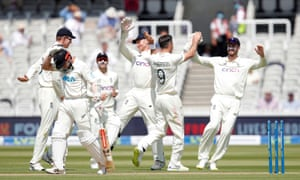England's James Anderson celebrates with teammates after taking the wicket of New Zealand's Kane Williamson.