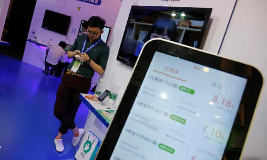 A man uses his mobile phone at the China internet conference in Beijing, July 2015.
