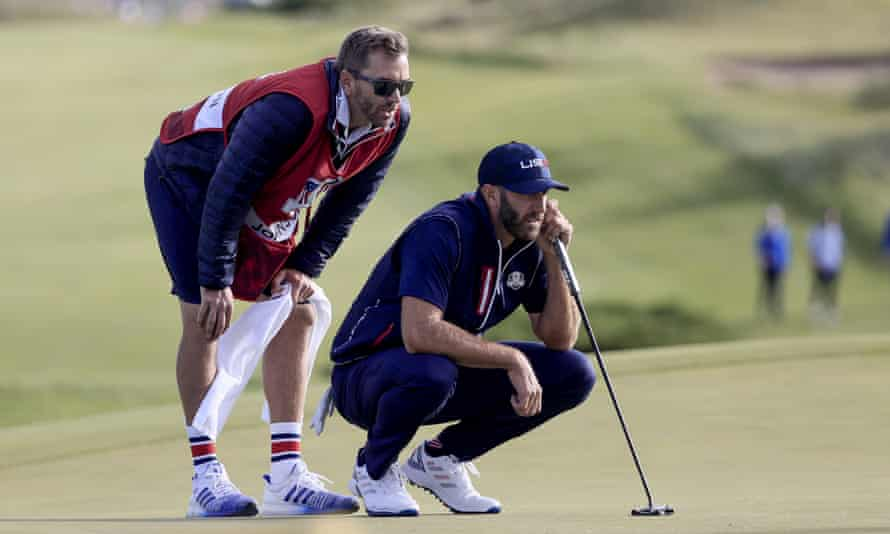 Dustin Johnson lines up his putt on the 11th in Saturday's fourballs