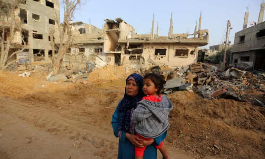 Palestinians return to houses destroyed by Israeli airstrikes, Beit Hanoun, Gaza, on 21 May 2021.