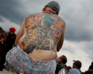 Demonstrator with an ICP-themed tattoo looks on during the Juggalo March in WashingtonA demonstrator with an Insane Clown Posse-themed tattoo looks on during the Juggalo March in Washington, U.S., September 16, 2017. REUTERS/Aaron P. Bernstein