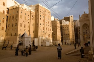 The shadows cast by Shibam's high-rises provide shade for the hot streets below.