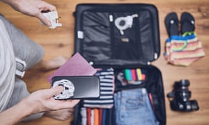 Young man packing for holiday