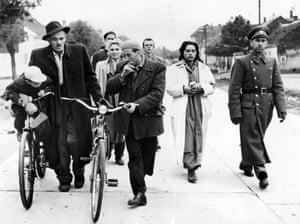 Hungarian refugees walk towards the Austrian border at Nickelsdorf in 1956.
