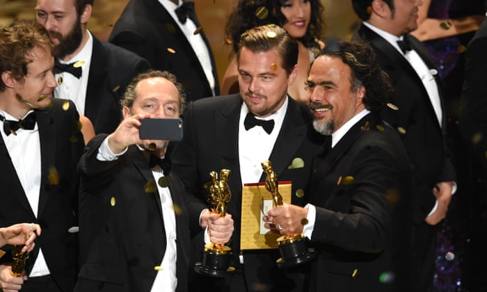 Cinematographer Emmanuel Lubezki, actor Leonardo DiCaprio and director Alejandro Gonzalez Inarritu, all winners for The Revenant, take a selfie onstage - Oscars 2016 Images/Photos -winners,list