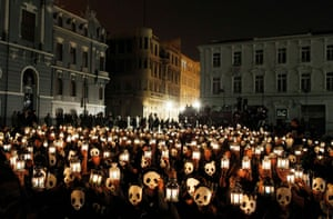 Chilean volunteers hold up candles during Earth Hour. Lights were turned off around the world in a show of support for renewable energy.