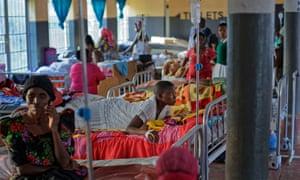 Expectant mothers lie on beds in the maternity ward of the Kalisizo General Hospital in Kalisizo, Uganda.