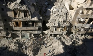 People dig in the rubble in an ongoing search for survivors at a site hit previously by an airstrike in the rebel-held Tariq al-Bab neighborhood of Aleppo, Syria, September 26, 2016