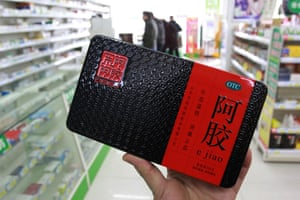 A customer shops for ejiao, or donkey-hide gelatin, at a pharmacy in Nantong, China.