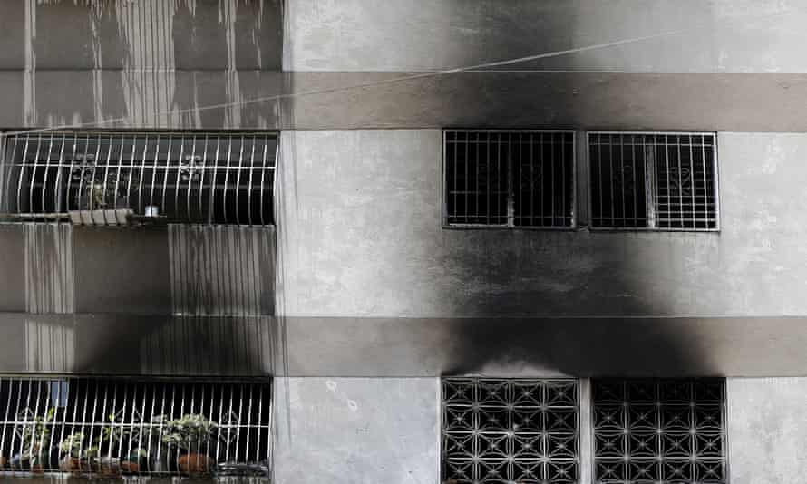 Smoke damage outside an apartment complex in Caracas