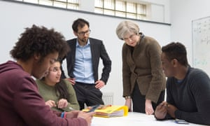 Theresa May with students and teacher