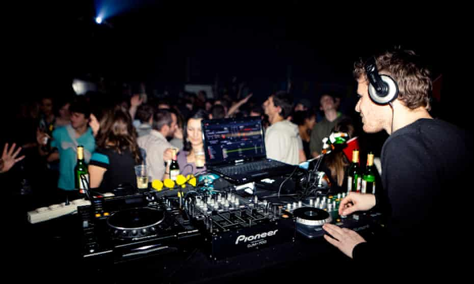 DJ performs to a crowed at OT301, Amsterdam