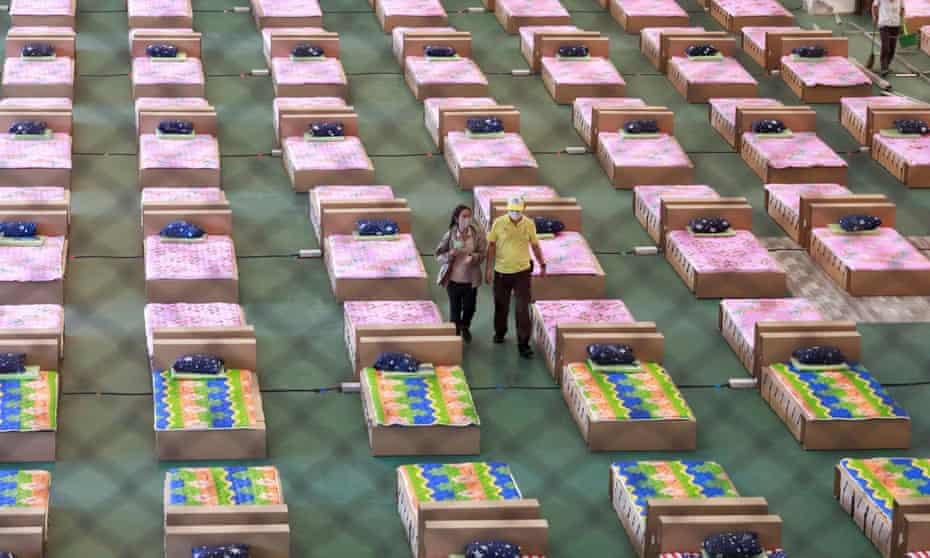 Volunteers prepare to convert an air cargo warehouse into a coronavirus field hospital at Bangkok airport