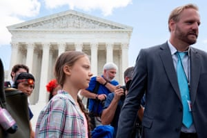 Greta Thunberg leaves after a gathering outside the US supreme court.