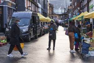 A market in Croydon, a large town of south London, UK on 18 January, 2021. 33,355 positive Covid cases have been recorded today, the lowest number of daily case since 27 December, before the start of England's third nationwide lockdown.