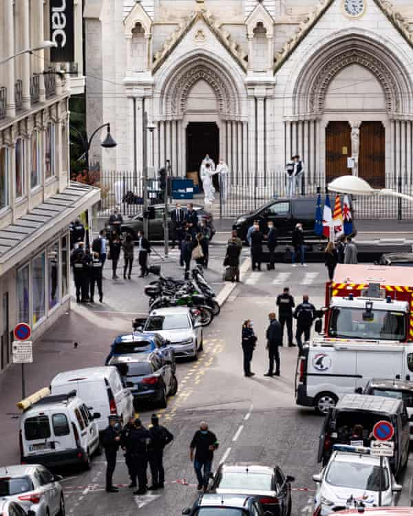 Police stand in front of the church after the attack.