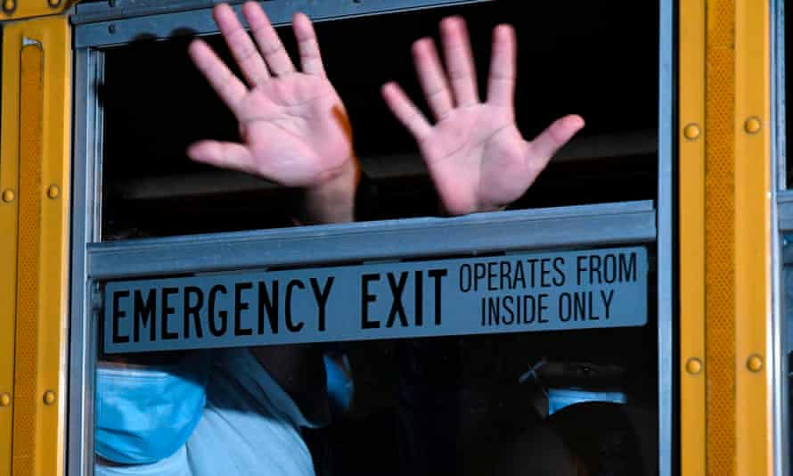 Migrants deported from the United States wave from a bus upon landing at the air force base in Guatemala City earlier this year.