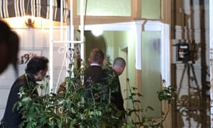 Australian federal police officers raid a home in Brunswick in inner Melbourne on Thursday night.