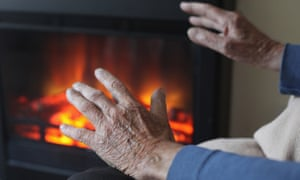 An elderly man warms his hands in front of a fire on October 6, 2011 in Bristol, England.