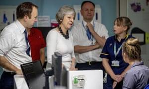 Matt Hancock on an NHS ward with the prime minister, Theresa May