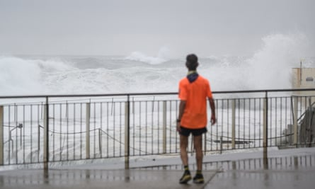 File photo of a person watching rough ocean conditions at Bronte beach in Sydney