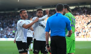 Derby players vent their frustration after seeing a penalty decision overturned.