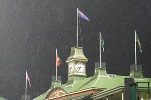 Rain pours down on to the roof of the Members stand at the SCG