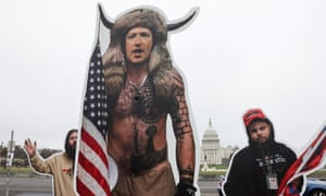 An art installation protest by the group SumOfUs portrays Twitter CEO Jack Dorsey and Facebook CEO Mark Zuckerberg as rioters from the 6 January attacks on the Capitol.
