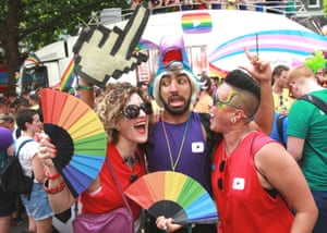 Mawaan Rizwan (centre), creator of a YouTube comedy channel, with friends during the parade