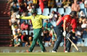 de Kock celebrates taking the catch to dismiss Malan.