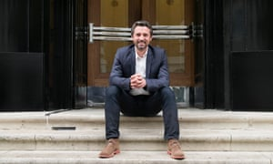 Rémi Garde sits on the steps to the entrance of Arsenal's old Highbury stadium. 'It is difficult for me to imagine the end for Arsène Wenger' says the former Gunner.