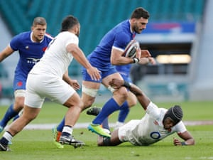 Charles Ollivon of France skips over Maro Itoje of England.