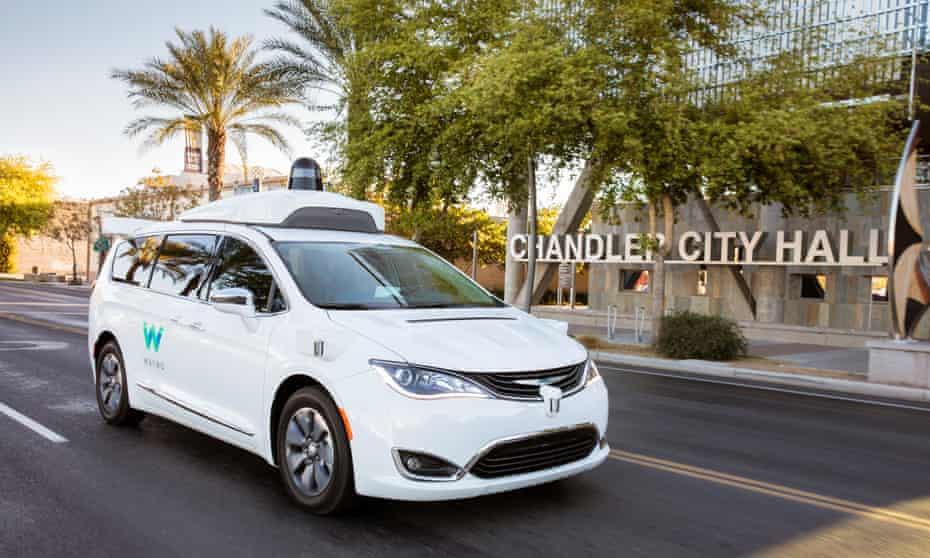 Waymo's self-driving Chrysler Pacifica hybrid minivan traverses public roads in Chandler, Arizona.