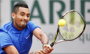 Nick Kyrgios returns during the first round of the French Open.