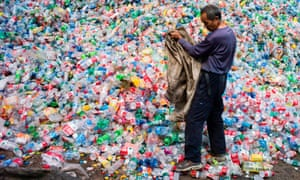 A Chinese labourer sorting out plastic bottles for recycling near Beijing.
