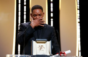 US actor Will Smith accepts the 70th anniversary award for Nicole Kidman during the Closing Awards Ceremony of the 70th Cannes Film Festival