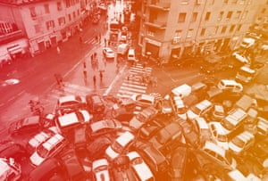 Cars swept into a pile by torrential rain in Genoa, Italy Saturday.