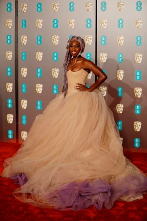 Cynthia Erivo gets her red carpet moment – taking things up a notch by matching her hair to the tulle on her Vera Wang dress