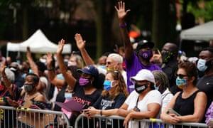 People gesture outside of Ebenezer Baptist church in Atlanta, Goergia during the memorial service of late US Congressman John Lewis