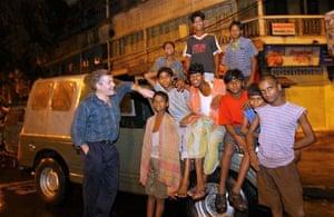 Tim Grandage outside his old car in Kolkata.