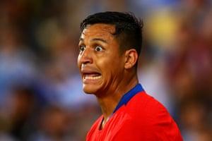 Alexis Chile's Alexis Sanchez reacts as Uruguay's Edinson Cavani's header gave Uruguay a 1-0 win over Chile.