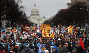 Protesters march during a demonstration against the Dakota Access pipeline on 10 March. Trump revived the project after taking office.