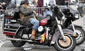 "A biker rests on his Harley-Davidson bike at the ""Hamburg Harley Days"" in Hamburg yesterday"