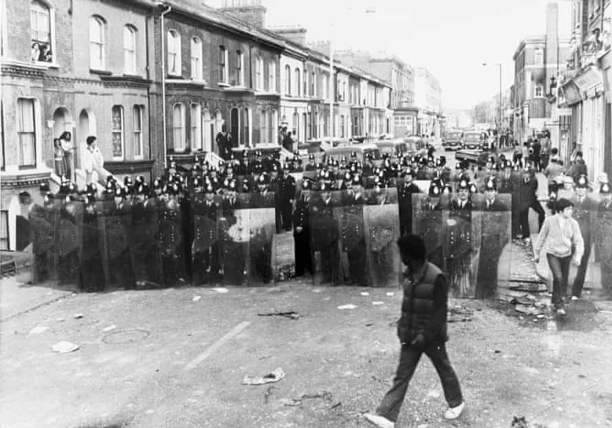 Police on the streets of Brixton during the riots in 1981