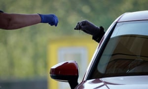 A driver returns a swab at a test centre in Sheffield