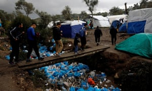 Conditions in the makeshift camp in the olive groves are dire, with insufficient shelter for new arrivals and rivers of rubbish.